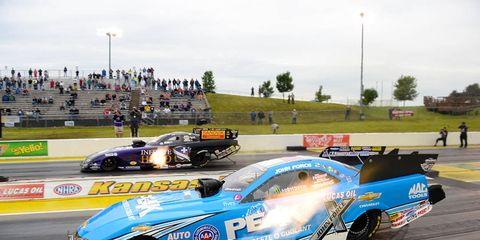 Jack Beckman, top, lines up against John Force for the Funny Car final in Kansas on Sunday.