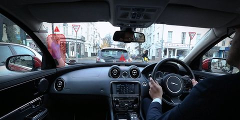Jaguar Land Rover is testing its augmented reality windshield.