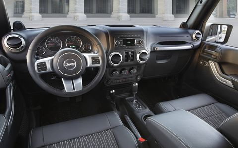 The interior of the 2014 Jeep Wrangler Freedom Edition feels rugged and hard-wearing.