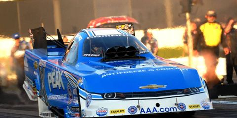 John Force took the top qualifying spot for Saturday's NHRA event in Colorado.