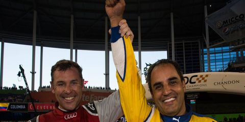 Juan Pablo Montoya, with runner-up Tom Kristensen, celebrates being crowned the Champion of Champions after the Race of Champions.
