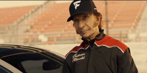 The ad features Emerson Fittipaldi, plus a mystery driver wearing two-tone nail polish.