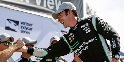 Team Penske's Simon Pagenaud celebrates his pole on Friday for the first of two races on Belle Isle in Detroit.