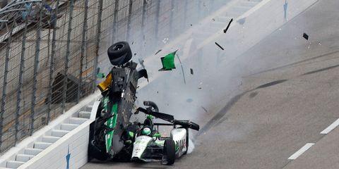 Automotive tire, Asphalt, Helmet, Auto part, Race track, Wire fencing, Motorsport, Mesh, Chain-link fencing, Fence,