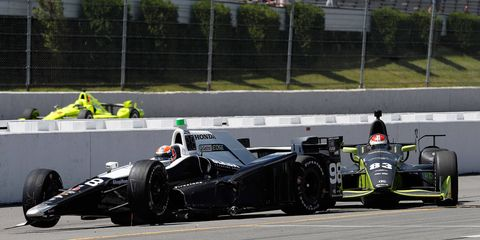 Alexander Rossi, left, and Charlie Kimball were involved in a pit-road crash that also collected Helio Castroneves at Pocono Raceway on Monday.