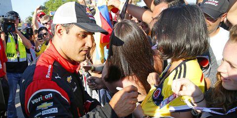 Team Penske driver Juan Pablo Montoya interacts with fans in St. Petersburg, Fla.