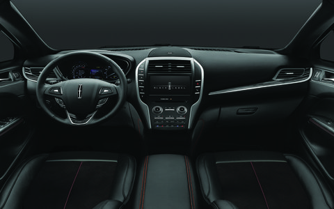 An MKC's interior sporting the theater and fashion-inspired Center Stage Black Label theme with jet black surfaces, foxfire red accent stitching and black stripe wood trim.