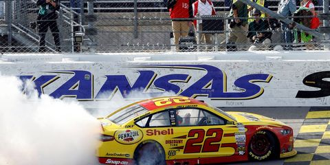 Joey Logano celebrates his win in the first race of NASCAR's Contender Round on Sunday at Kansas Speedway.