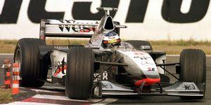 Mika Hakkinen drives his MP4-13 at Suzuka during his 1998 championship season.