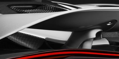 Automotive design, Automotive exterior, Carbon, Orange, Logo, Supercar, Luxury vehicle, Synthetic rubber, Personal luxury car, Kit car,