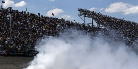 Sprint Cup driver Jimmie Johnson's burnout following his win at Michigan International Speedway in June.