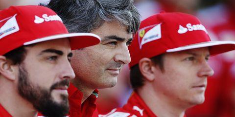 Former Scuderia Ferrari boss Marco Mattiacci between drivers Fernando Alonso and Kimi Raikkonen before the Abu Dhabi Grand Prix.