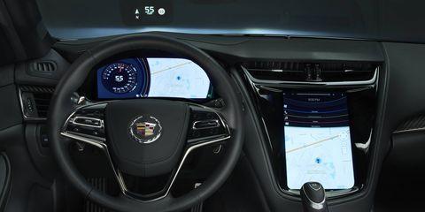 Motor vehicle, Mode of transport, Automotive design, Steering wheel, Steering part, Car, Speedometer, Trip computer, Luxury vehicle, Gauge,