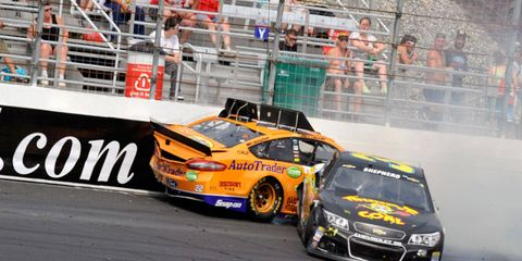Morgan Shepherd, right, collides with Joey Logano (22) during the early stages of Sunday's NASCAR Sprint Cup Series race at New Hampshire Motor Speedway.