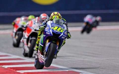 """Early in the race, with Marc Marquez leading, Valentino Rossi got around the first lap leader Andrea Dovizioso and led both rejuvenated Ducatis. Later, with his front tire fried, Rossi had to """"race in a more careful way,"""" and Dovi passed him for a strong second place.  Rossi was elated to finish on the podium as historically COTA has not been a great track for the Yamahas."""