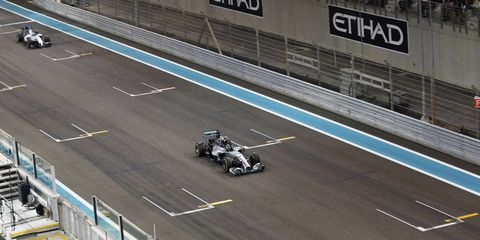 Mercedes' Nico Rosberg leading Williams F1 driver Felipe Massa at Yas Marina Circuit.