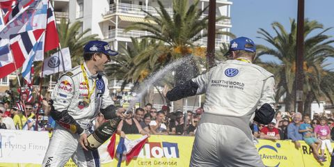 Sébastien Ogier and Jari-Matti Latvala celebrate after winning the World Rally Championship.