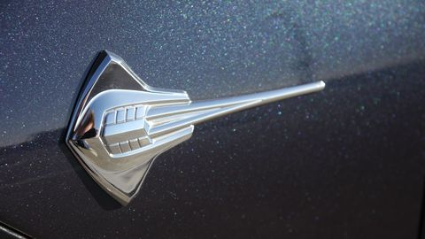 We would pay good money to have one of these cool logos as a lapel pin. Note the intake manifold pattern on the back of the Stingray.