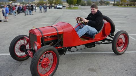 Red Model T underway at the Horseless Carriage Club's Holiday Excursion.