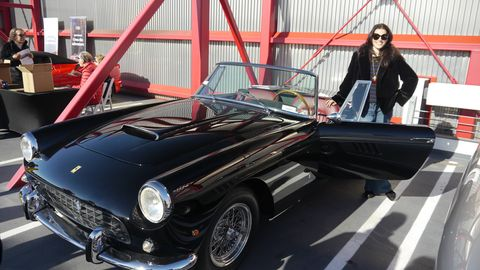 The Ferrari Club of America Southwest Region celebrated Enzo Ferrari's 120th birthday with a gathering of 200 Ferraris at the Petersen Automotive Museum. Here, one of the beautiful people of Los Angeles enjoys the presence of a 1962 250 GT Series II PF Cabriolet, brought by Eric Sander of GTO Engineering. Happy Birthday, Enzo!