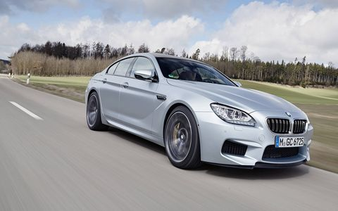The M6 Gran Coupe's tall belt lines and slammed roof look great from the street. Inside, however, it can get cavelike.