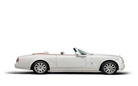 The exterior of this Maharaja inspired super-luxury vehicle dazzles in a Carrara White colour, with a Peacock emblem, the national bird of India, completing an Emerald green coachline.
