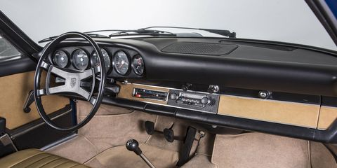 Vintage 911 dashboard or reproduction part? You can't tell, and that's the point.