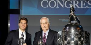 Will Power, left, and team owner Roger Penske picked up some hardware in Detroit on Wednesday.