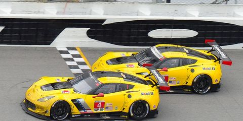 Oliver Gavin leads his Chevrolet Corvette C7.R to a less-than-a-car-length victory in the Rolex 24 at Daytona on Sunday.
