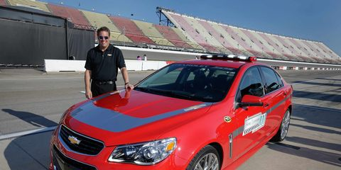 Mark Reuss and the Chevy SS that will lead the field at Michigan International Speedway.