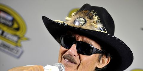 The King, Richard Petty, wearing his feathered crown, commands the room.