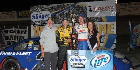 Matt Kenseth poses with son Ross after a win at Wisconsin's Slinger Super Speedway. This weekend, Ross will make his NASCAR Xfinity Series debut.