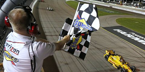 Ryan Hunter-Reay takes the checkered flag on Saturday night at Iowa Speedway. It was his first win on the Verizon IndyCar circuit since he won the Indianapolis 500 in May.