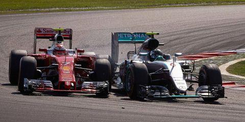 Ferrari's Kimi Raikkonen, left, and Nico Rosberg, right, will battle in Japan early Saturday morning.