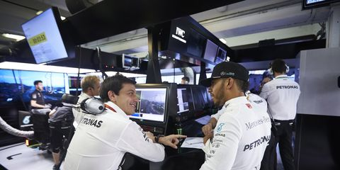 Mercedes chief Toto Wolff, seen speaking with driver Lewis Hamilton, has slammed rumors that Mercedes is planning to leave F1.