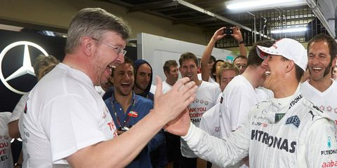 Ross Brawn, left, and Michael Schumacher, right, during happier times.