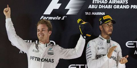 Nico Rosberg celebrates the Formula 1 championship in Abu Dhabi, while teammate Lewis Hamilton, right, settles for the runner-up position in the final standings.