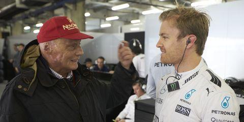 F1 legend Niki Lauda, left, believes Sebastian Vettel and Nico Rosberg, right, must become more relatable.
