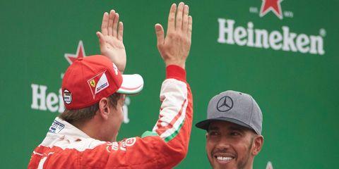 Don't look for Ferrari's Sebastian Vettel, left, and Lewis Hamilton to be teammates at Mercedes.