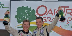 Level 5 Motorsports owner and driver Scott Tucker (right) with driver Ryan Briscoe following their P2 win at Virginia International Raceway in 2013.