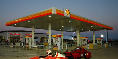 Kimi Raikkonen beats Ferrari teammate Fernando Alonso to the turn at the gas pumps during their exhibition in Austin, Texas.