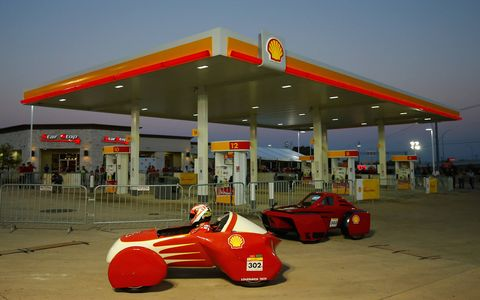 Kimi Raikkonen beats Ferrari teammate Fernando Alonso to the turn at the gas pumps during their exhibition in Austin, Texas.