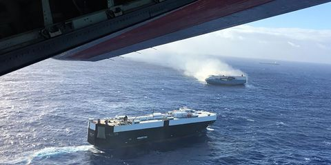 A photo taken Dec. 31, 2018 from a Coast Guard HC-130 Hercules shows the burning Sincerity Ace in the background. Another vehicle carrier is in the foreground.