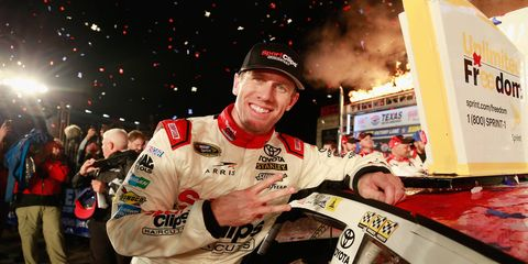 Carl Edwards poses in victory lane with the winner's decal after the rain-shortened NASCAR Sprint Cup AAA 500 at Texas.