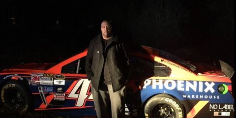 Team Xtreme owner John Cohen stands in front of his team's recovered race car. The car was stolen Friday morning from the parking lot of the hotel the team was staying in.