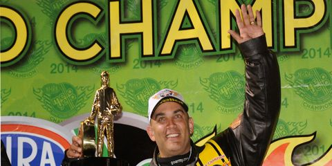 Tony Schumacher celebrates his NHRA Top Fuel championship on Saturday.