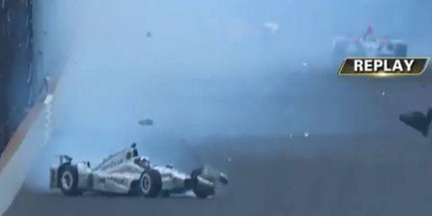 Juan Pablo Montoya hits the wall at the Indianapolis Motor Speedway.