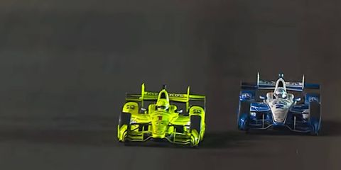 Josef Newgarden, right, sets up teammate Simon Pagenaud for the late pass and the IndyCar win at Gateway Motorsports Park on Sunday.