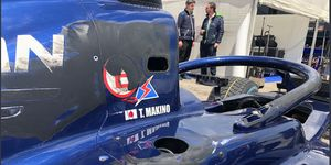 Tadasuke Makino's Formula 2 car shows the path of a tire that ran up the side of the car during a crash in Barcelona.