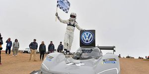Dumas, victorious, with the VW I.D. R electric car.